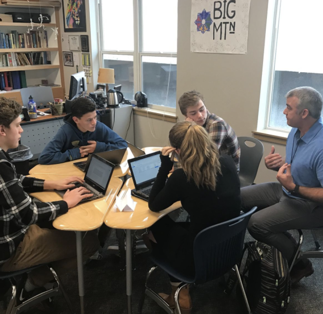 Four students working with a Writing Coach