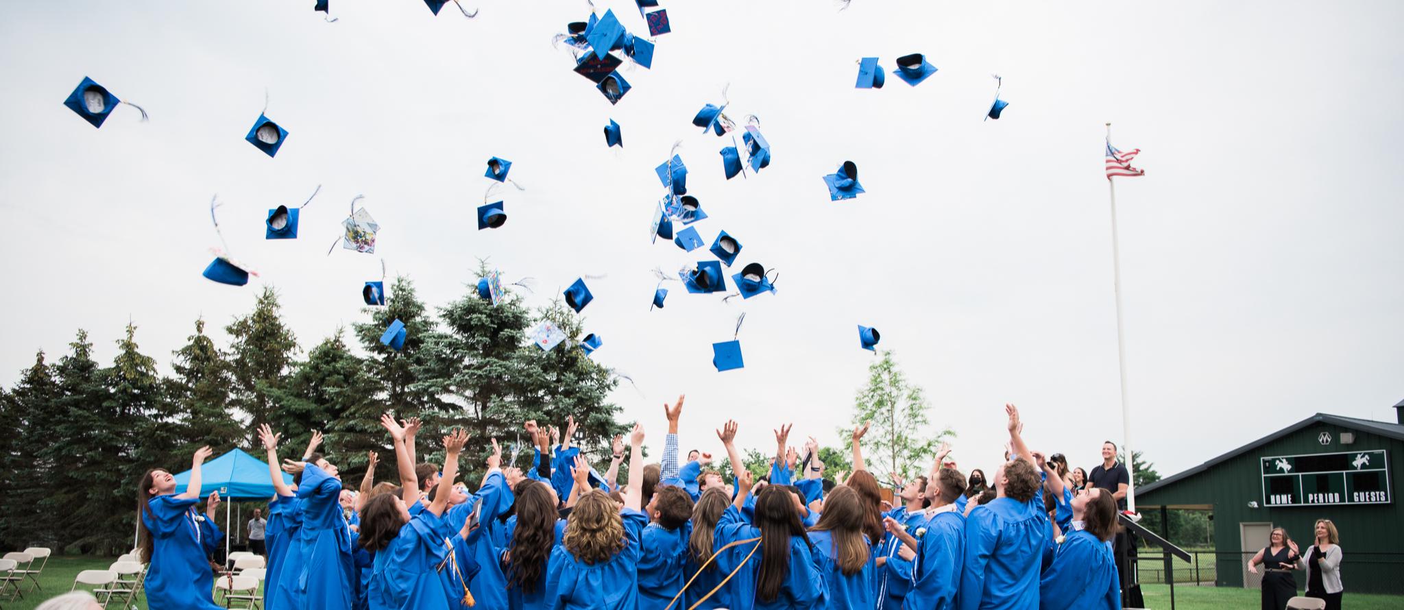 LPS Graduates throwing Caps in Air