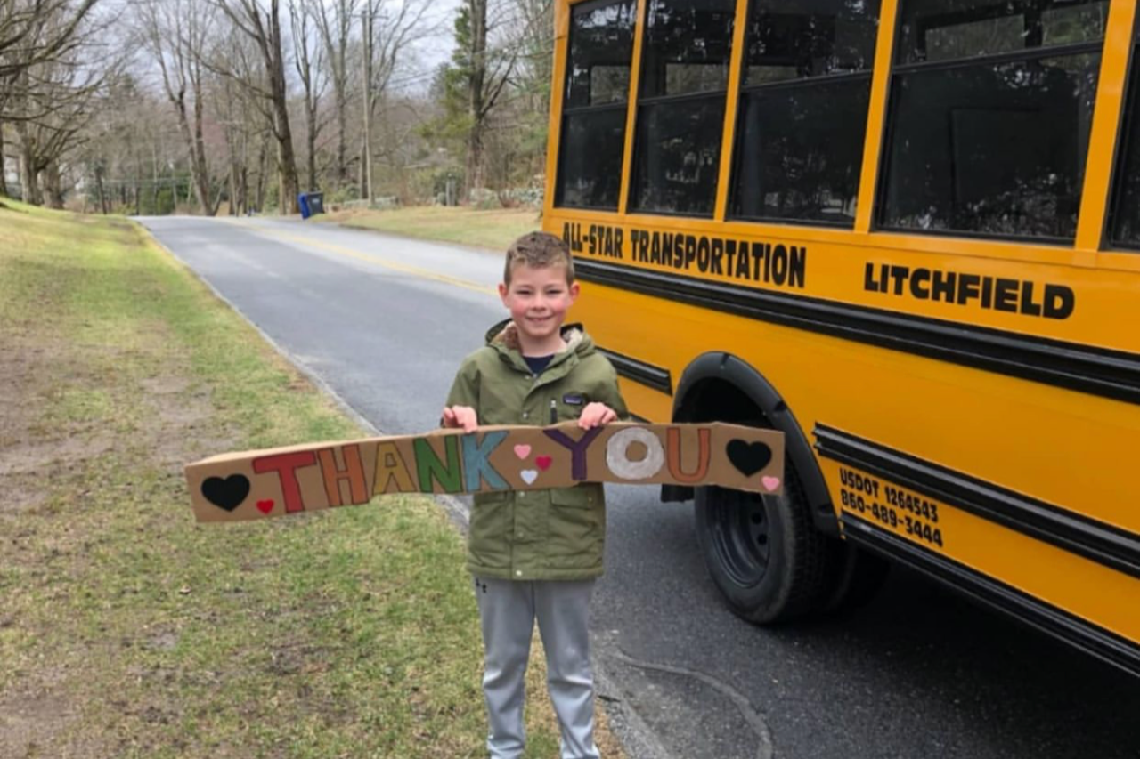 Bus with Student Holding a Thank You Sign