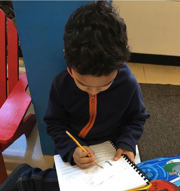 Student Writing in Book