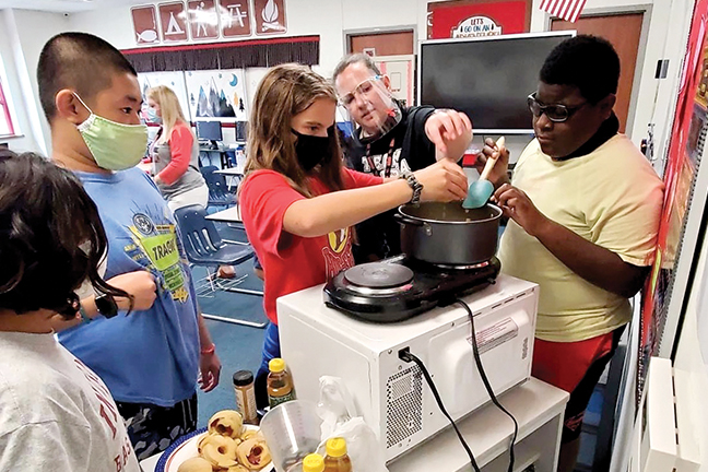 Students learn to cook using safety measures