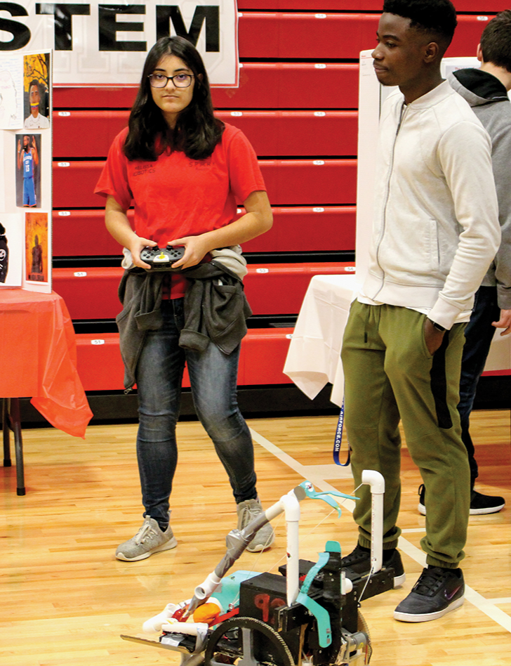 Robotics students show their robot at the Melissa High School Academic Expo