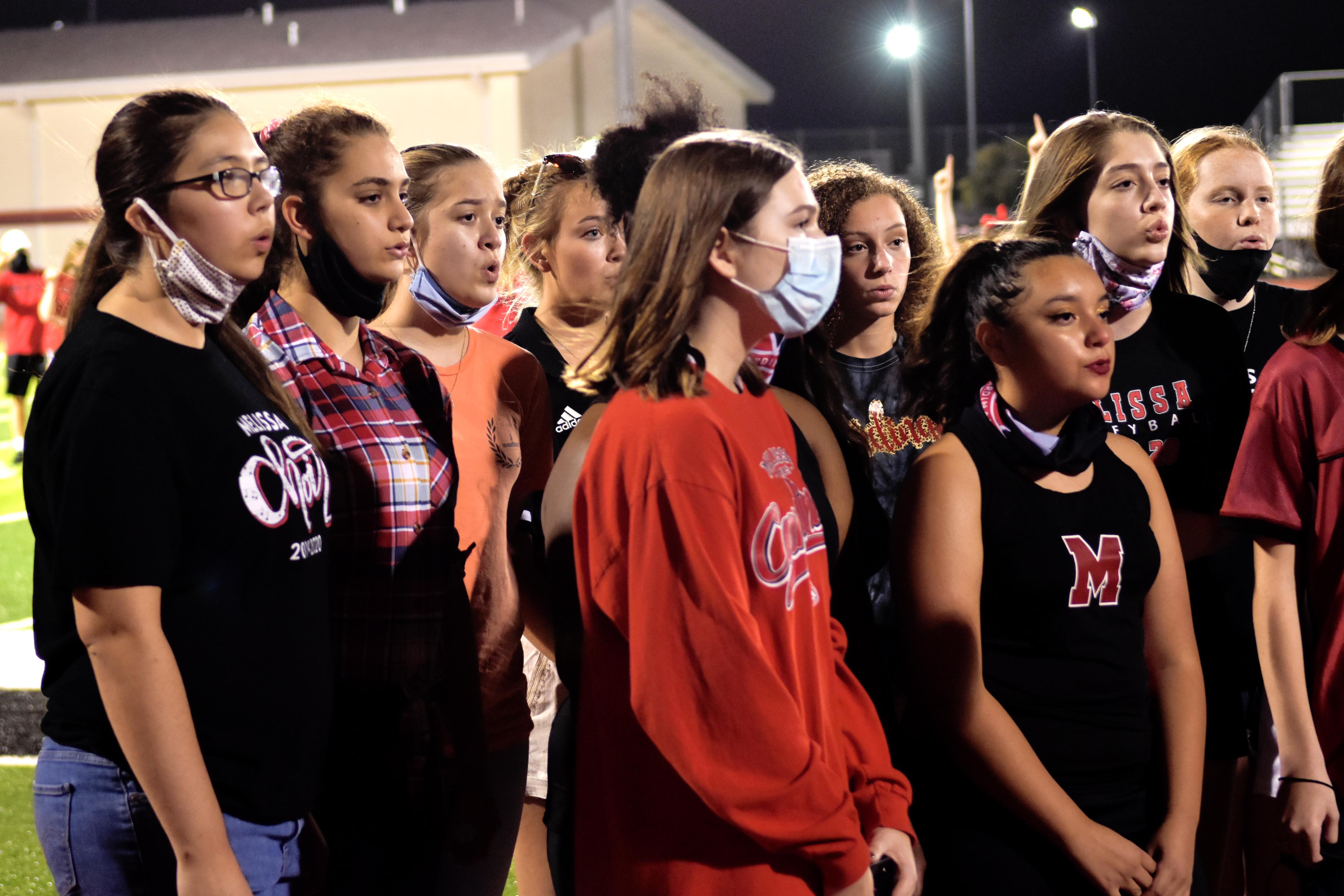 Choir students perform at Homecoming pep rally