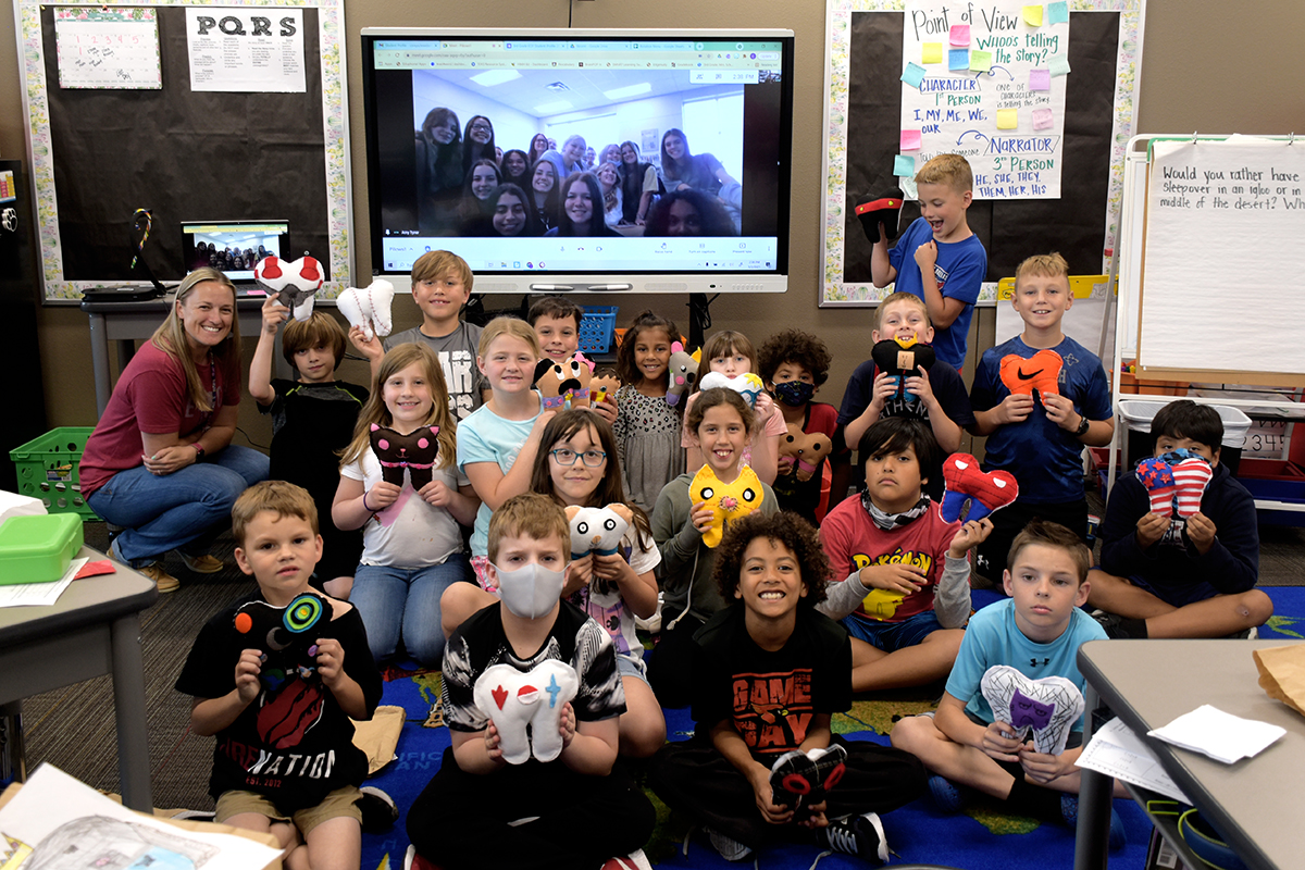 CTE students present elementary students with hand-sewn tooth fairy pillows