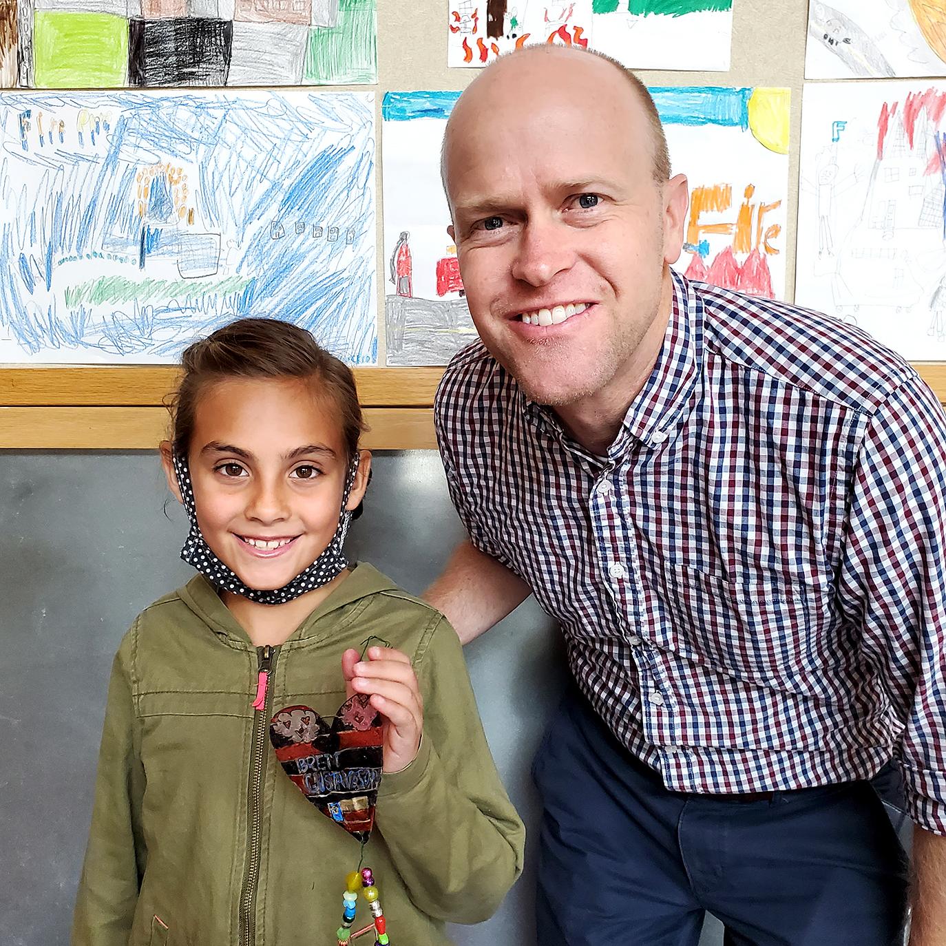 Brett Gustaveson with student