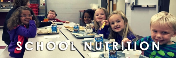 "photo of kids eating lunch that says ""nutrition"""