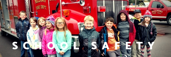 "photo of students in front of a firetruck that says ""school safety"""