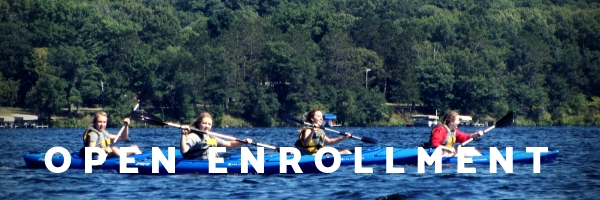 "photo of kids kayaking that says ""open enrollment"""