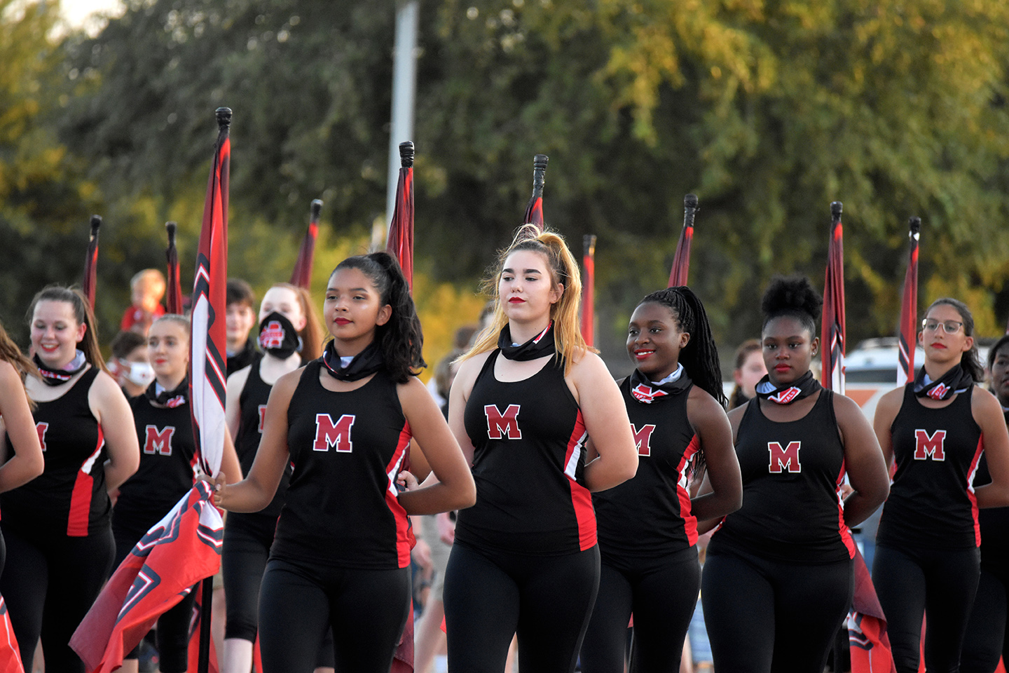 Colorguard students walk in the Homecoming Parade