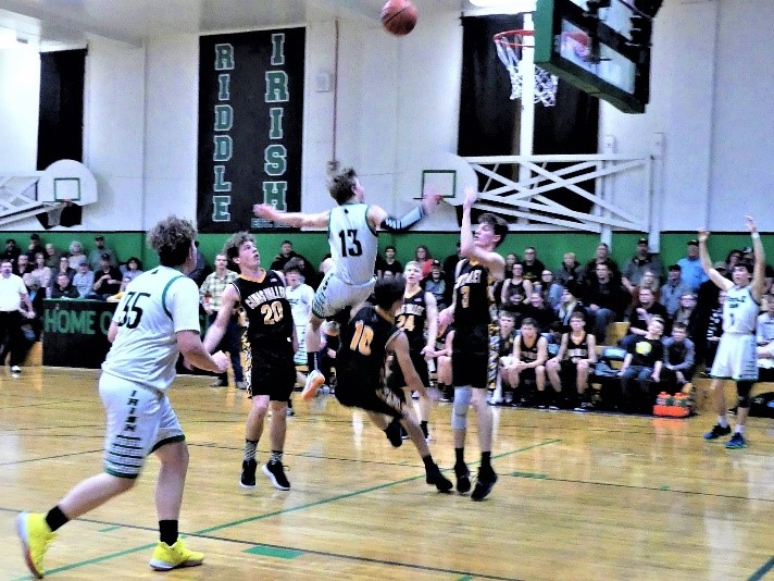 A Riddle basketball player goes up for a basket.