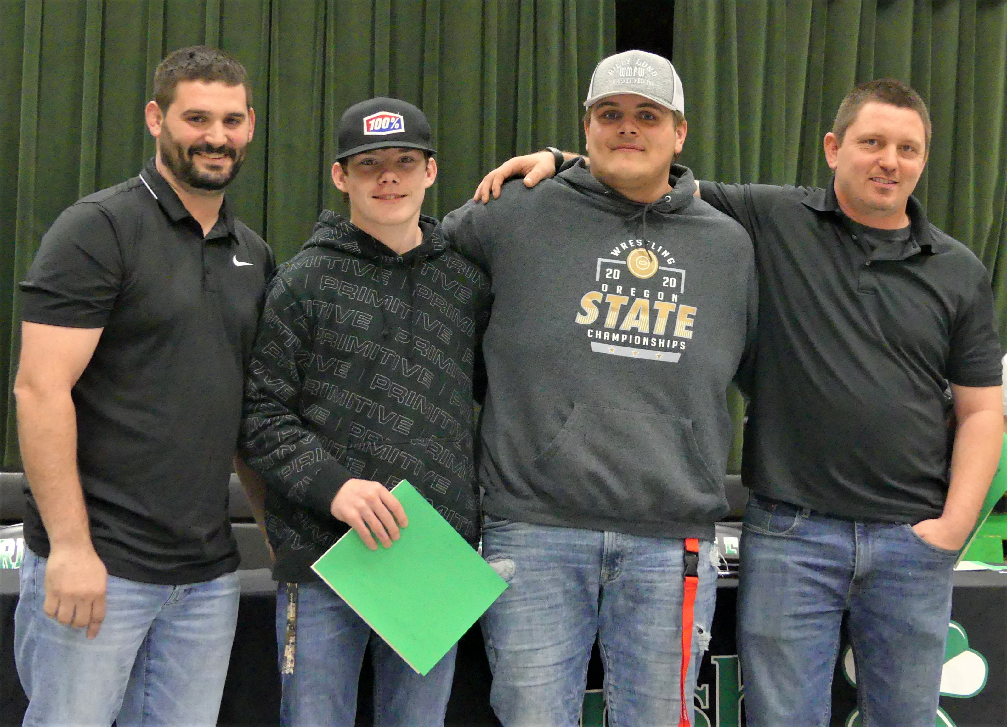 Wrestling coaches with Riddle wrestlers