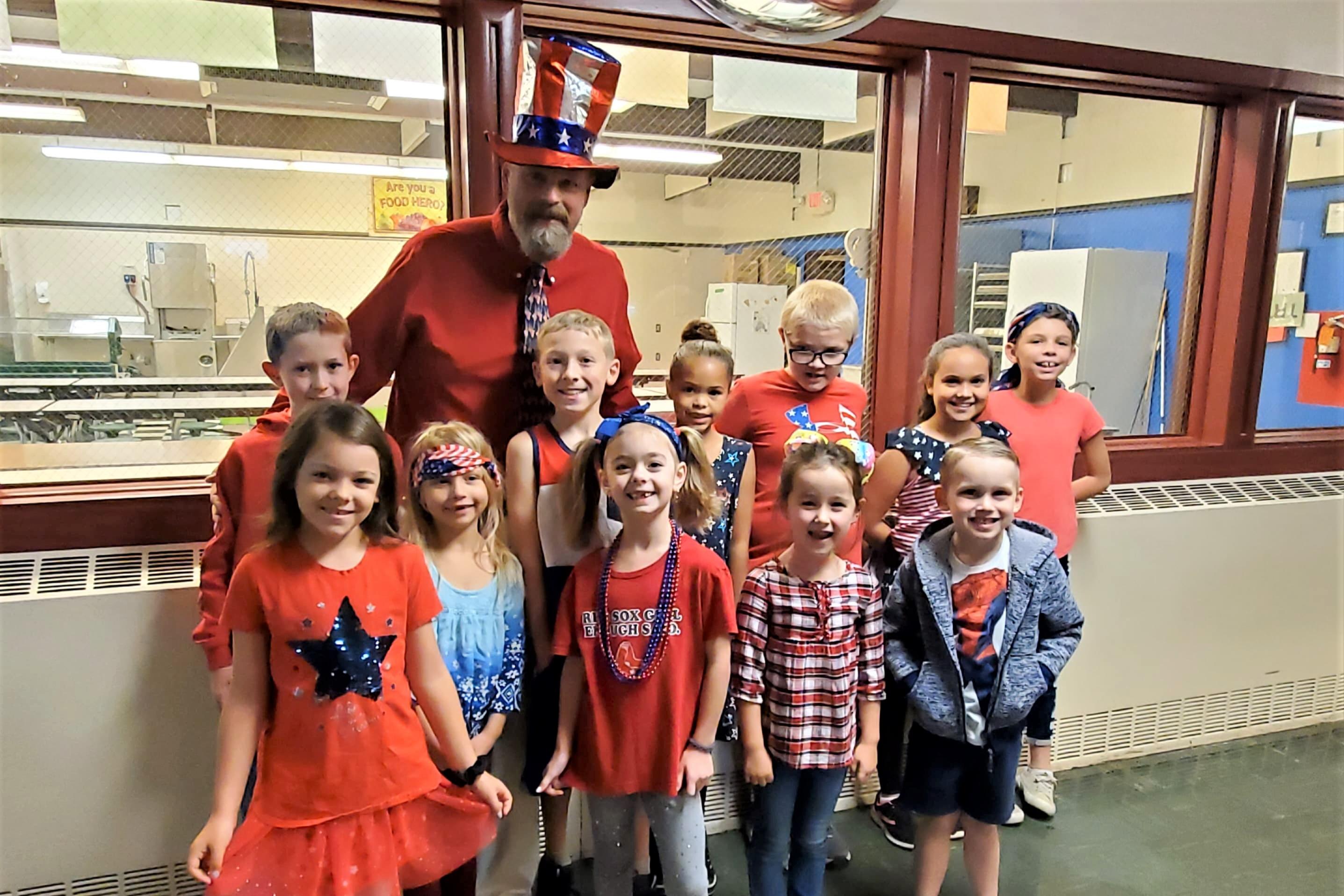 Mr. Gianotti with students celebrating patriotism.