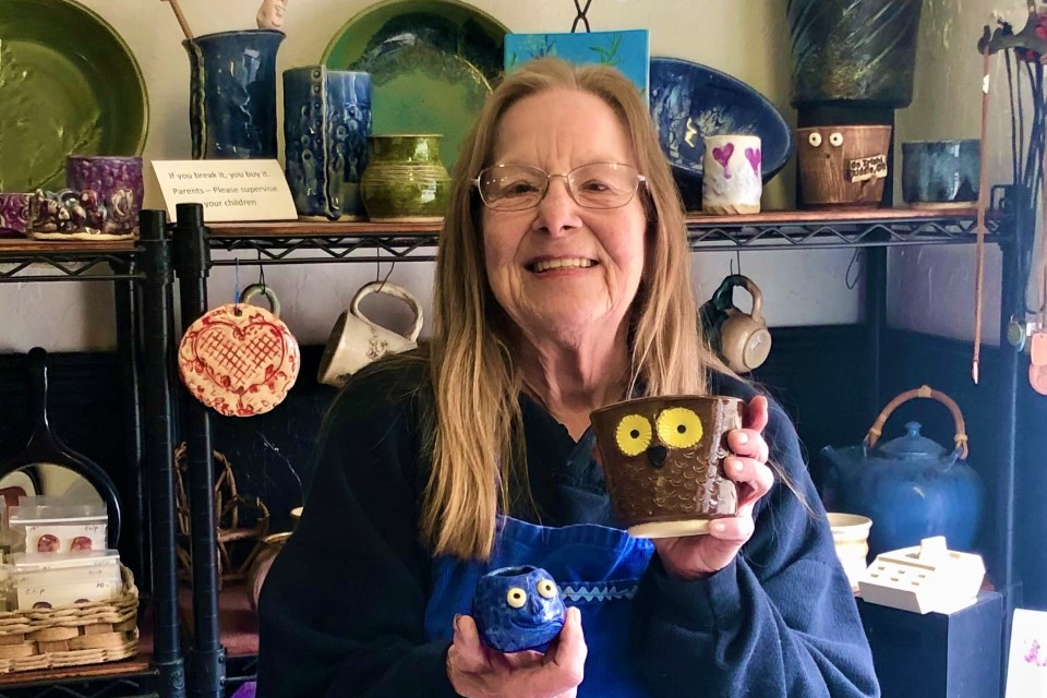 Carol Ratliff, guest pottery teacher at Riddle Jr./Sr. High School displays some pottery in her shop.