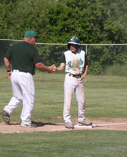 Coach at base with Riddle player.