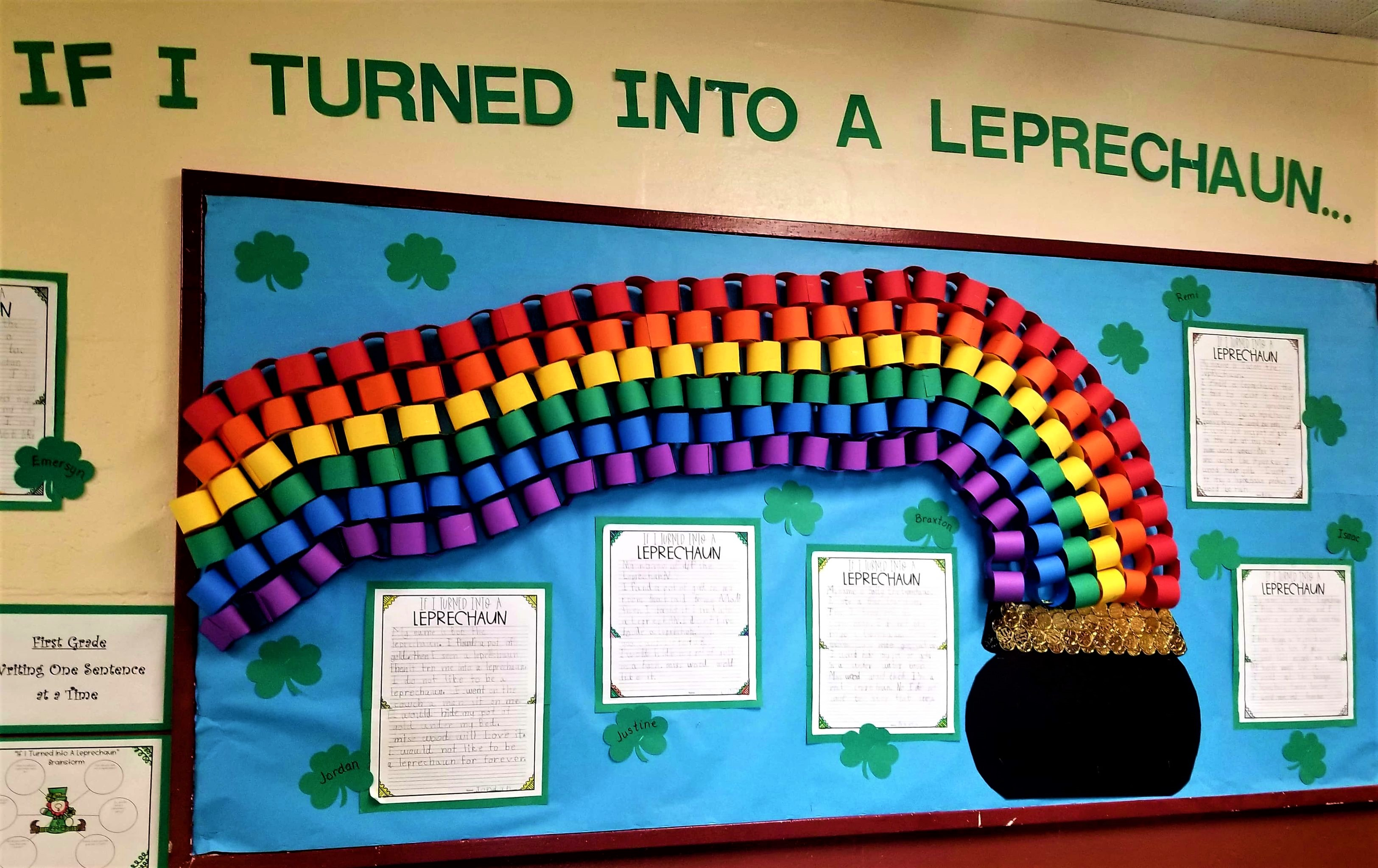 February board that you see at RES as you enter the school decorated with craft rainbow and pot of gold.