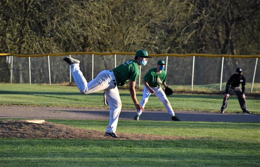 Riddle baseball game against Oakland. Riddle pitcher throws from the mound.