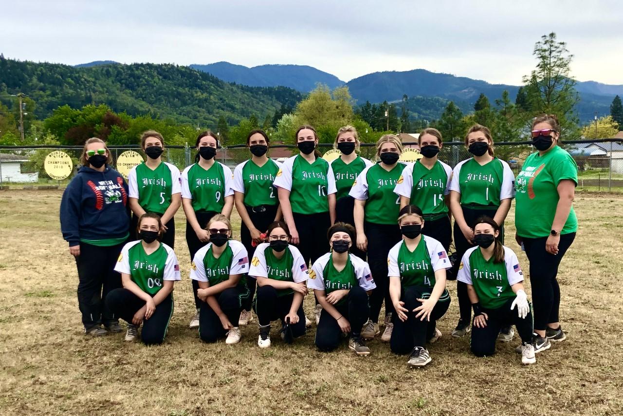 Softball team with coaches