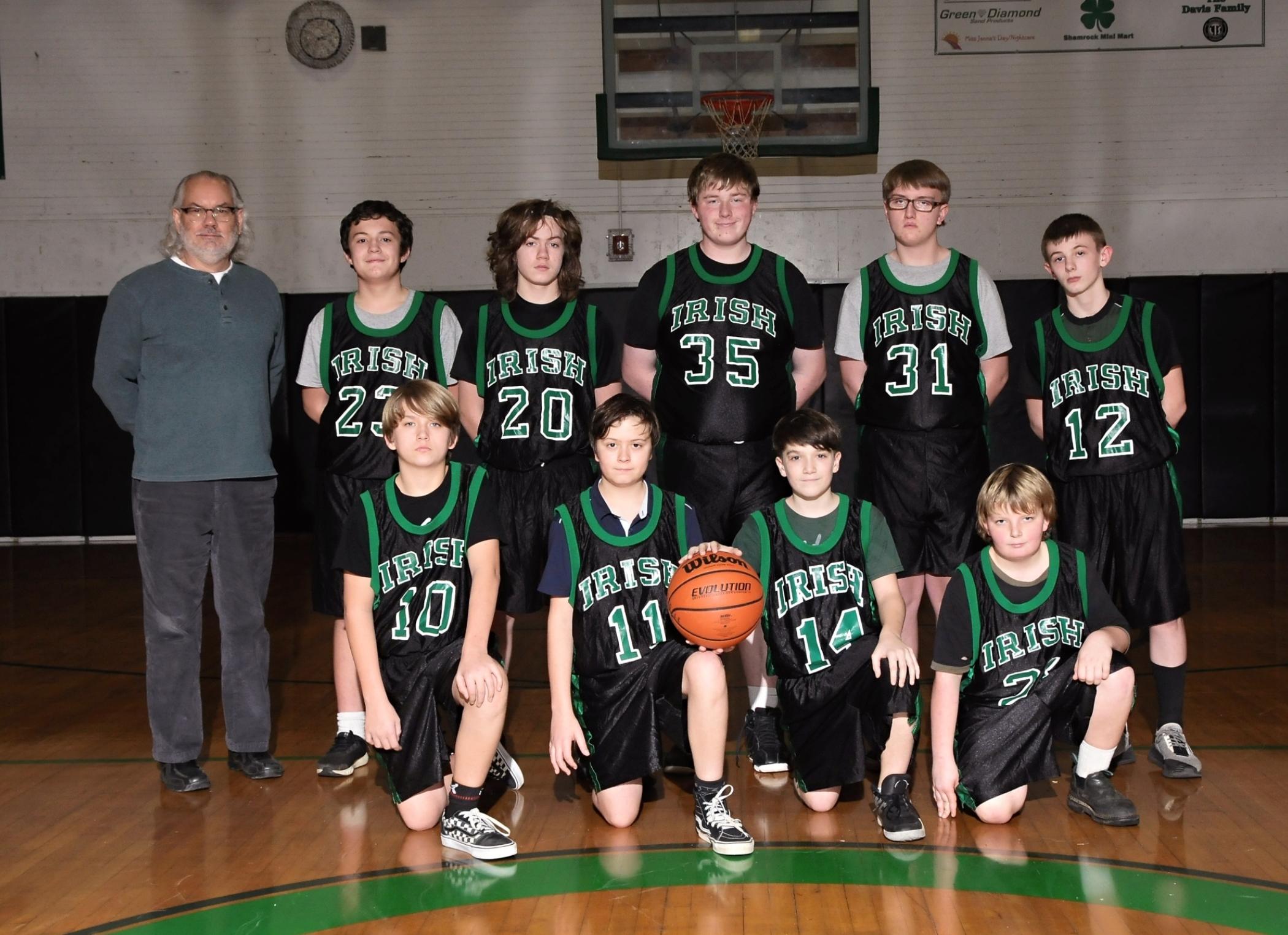 Riddle Junior High School boys basketball team photo.