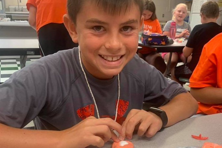 Camper shows his creativity with air drying clay.