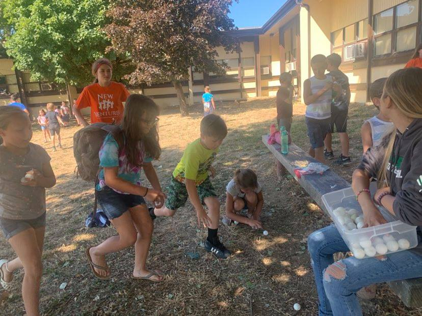Campers participating in an egg activity outside.