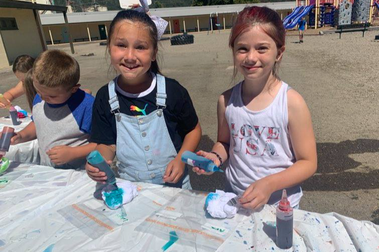 Campers make some tie dye creations!