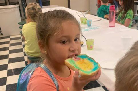 Fun in the cafeteria at New Ventures Camp! Bread painting and eating?!