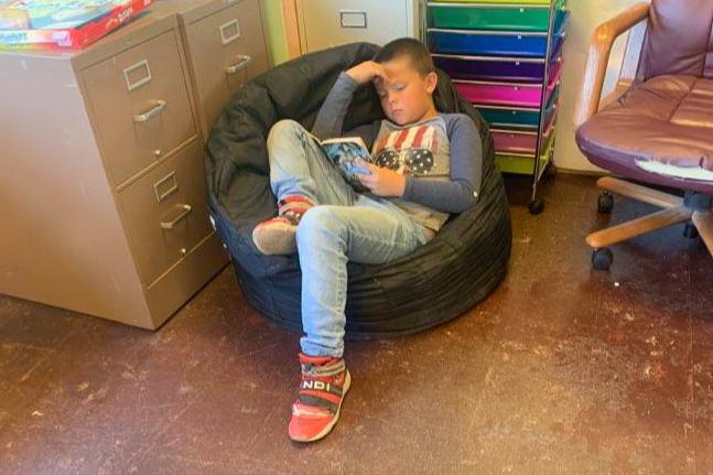 New Ventures Campers enjoy reading!