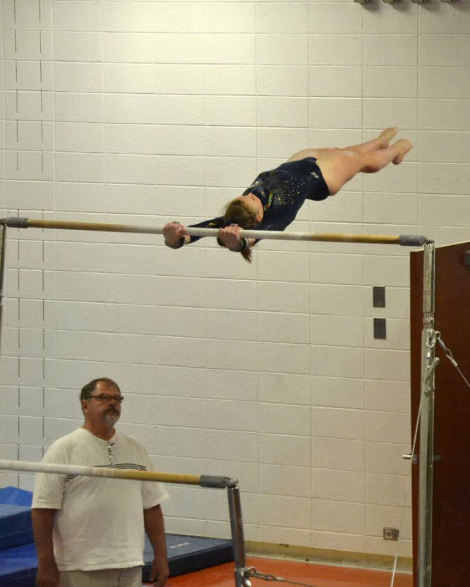 Lone Star Proud      Alivia on the uneven bars