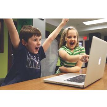 Children cheering at a laptop
