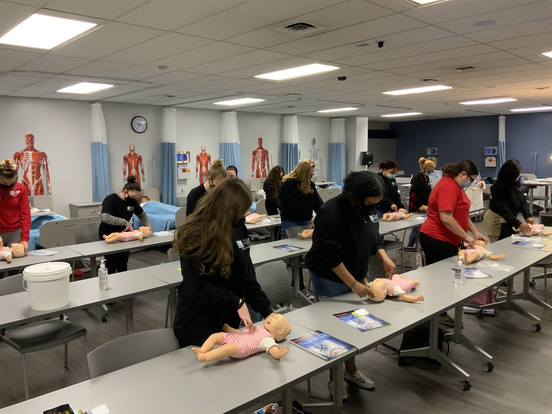 Student learning infant CPR