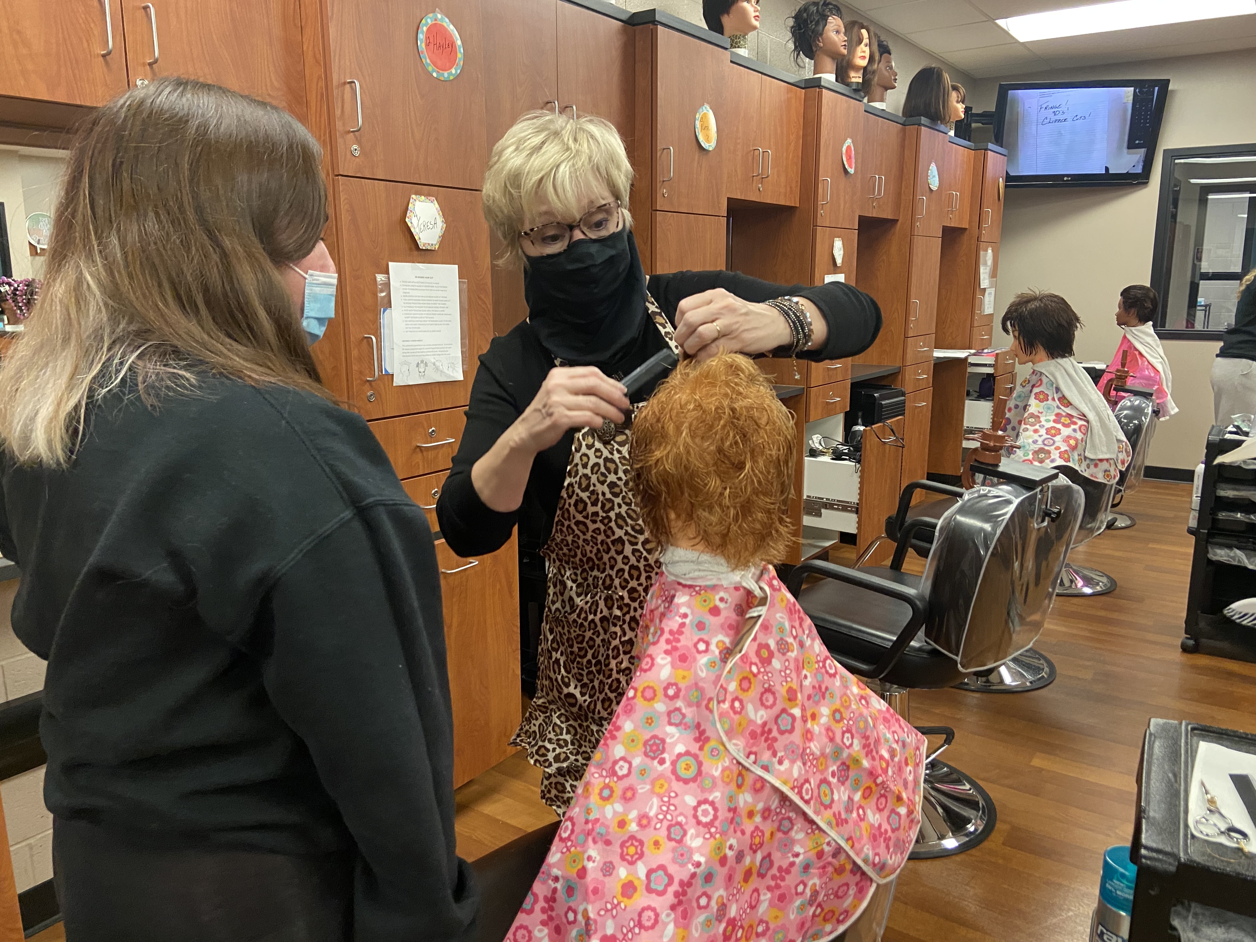 Instructor  giving lesson on mannequin