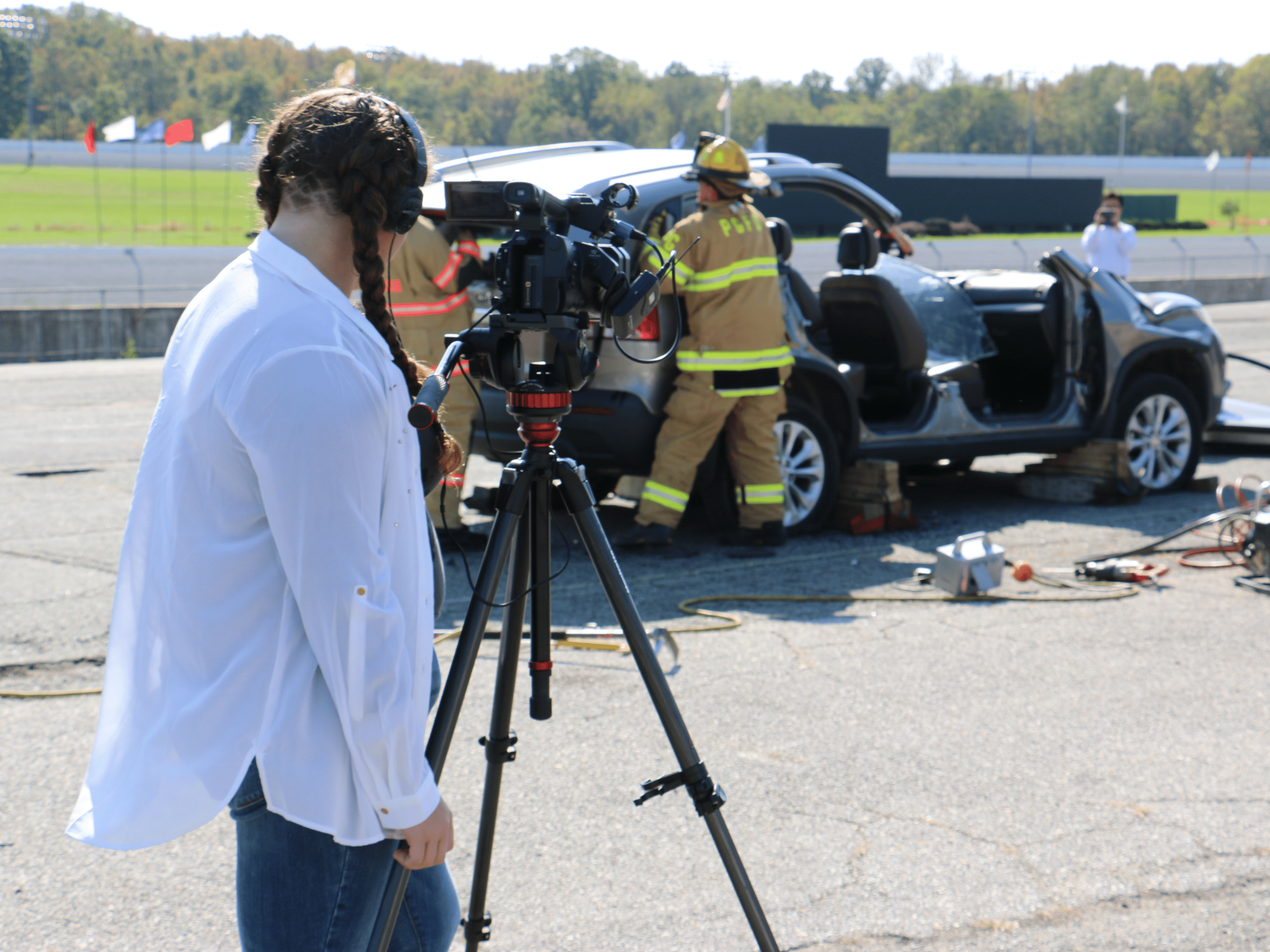 Students filming a fire scene