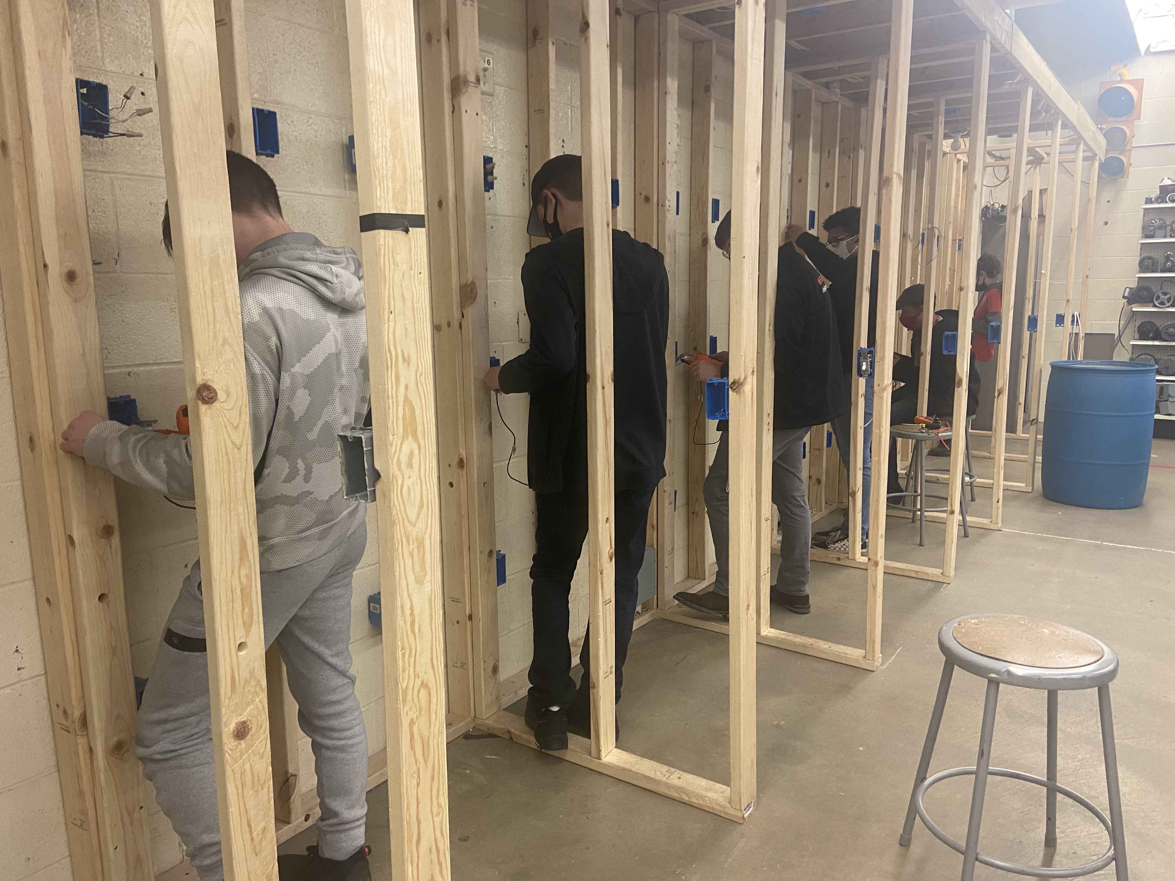 Several electrical students wiring