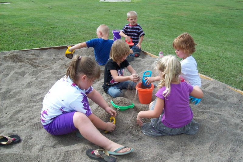 Students playing in the sandbox