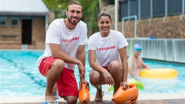 portrait-male-female-lifeguards-holding-rescue-1068x600