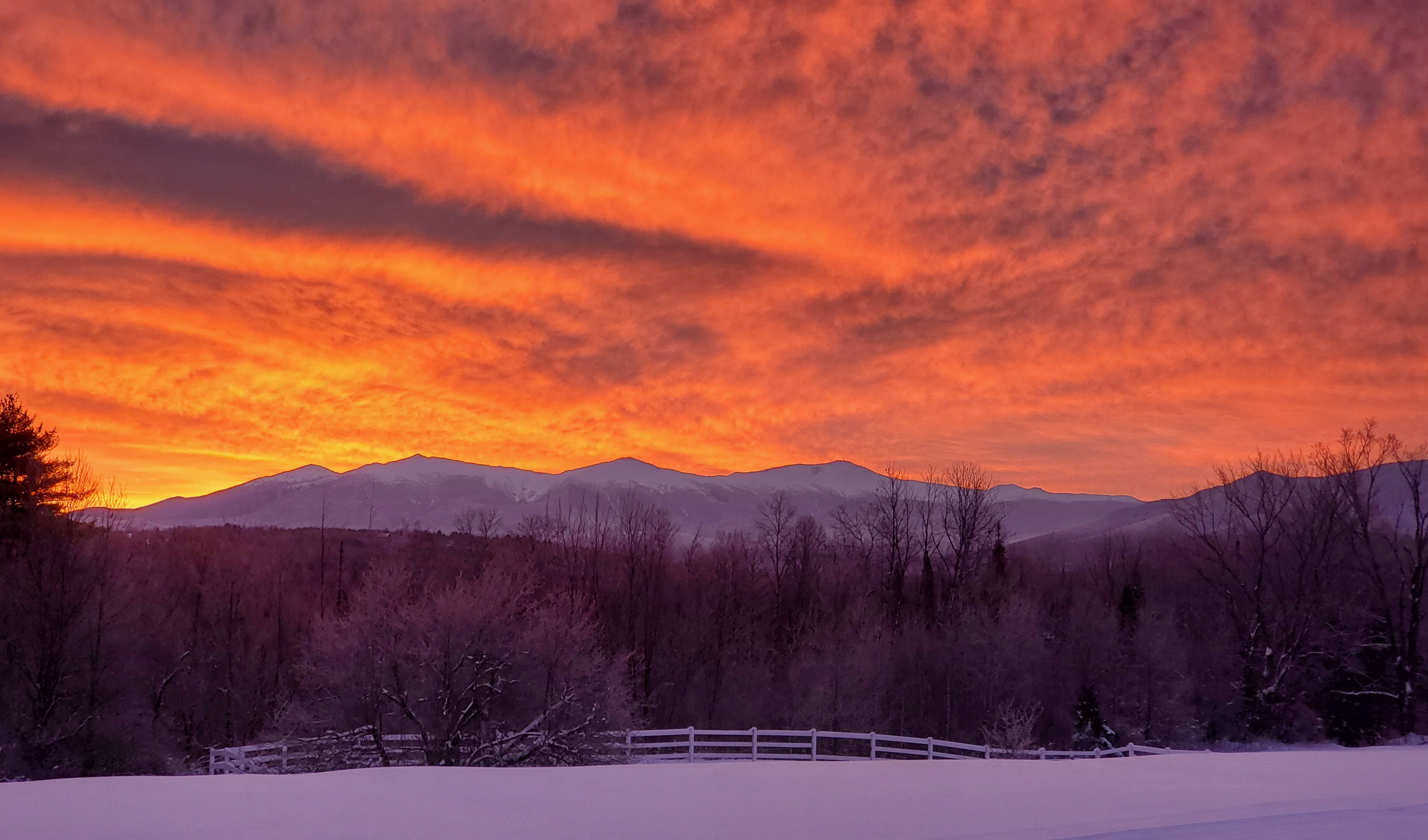 White Mountains Covered In Snow at sunset.