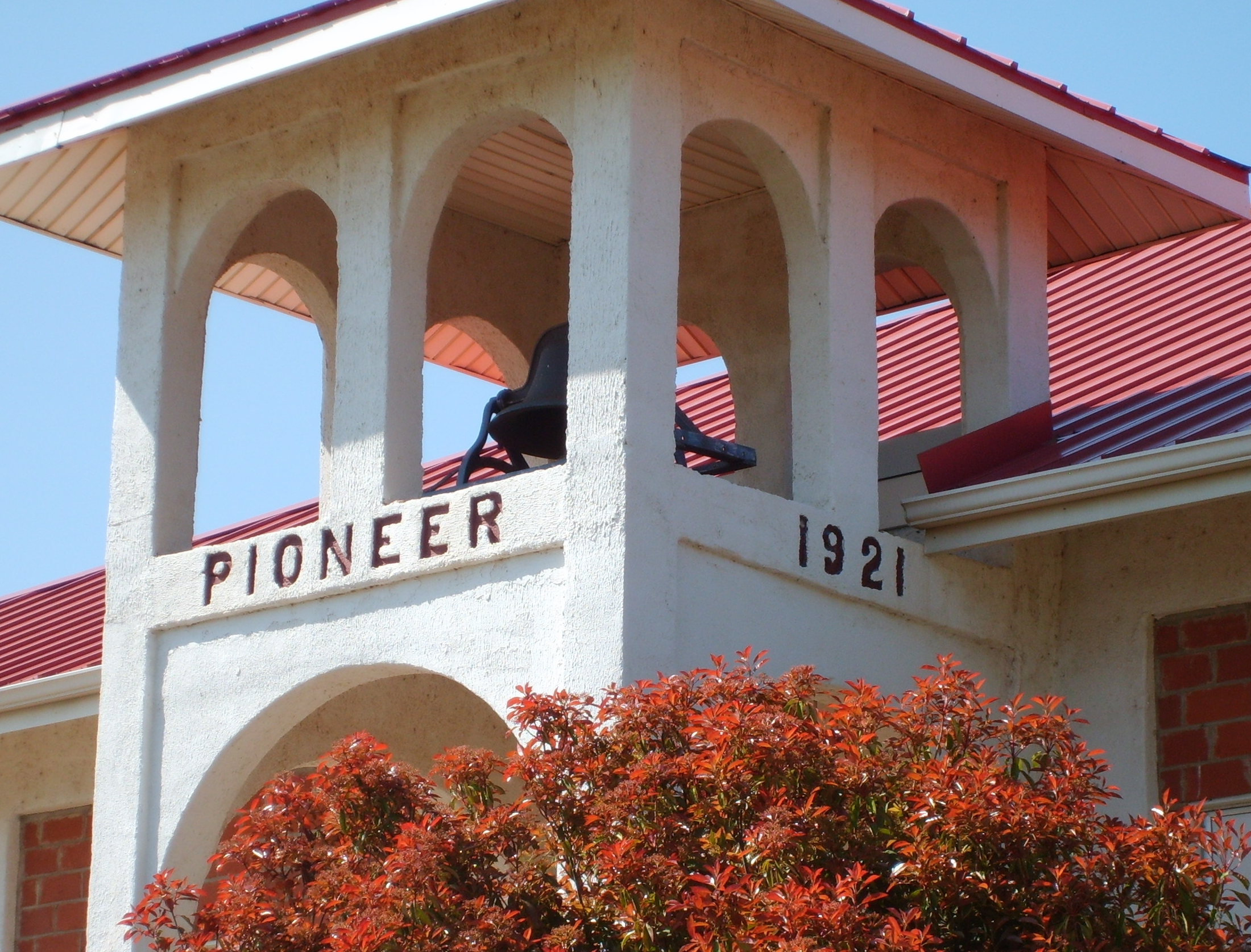 A photo of the bell tower on the outside of Pioneer-Pleasant Vale school