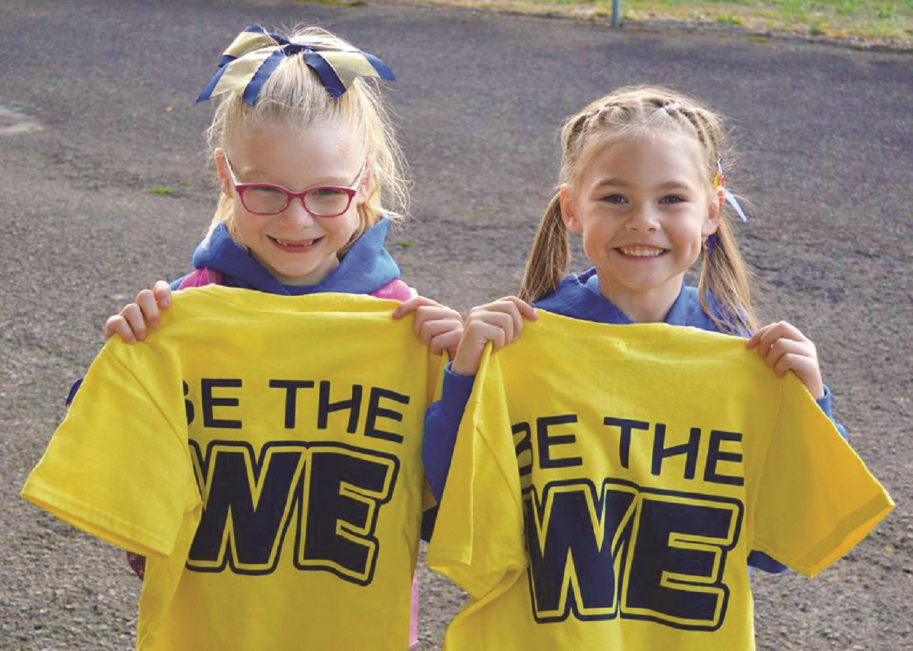 Girls with Be The WE t-shirts