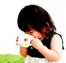 A toddler drinking from a cup