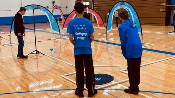 Two students at a robotics tournament.