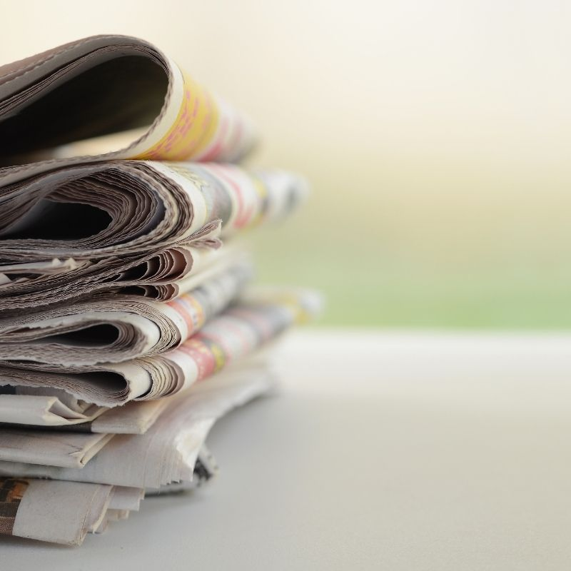 Picture of Newspapers stacked on top of each other