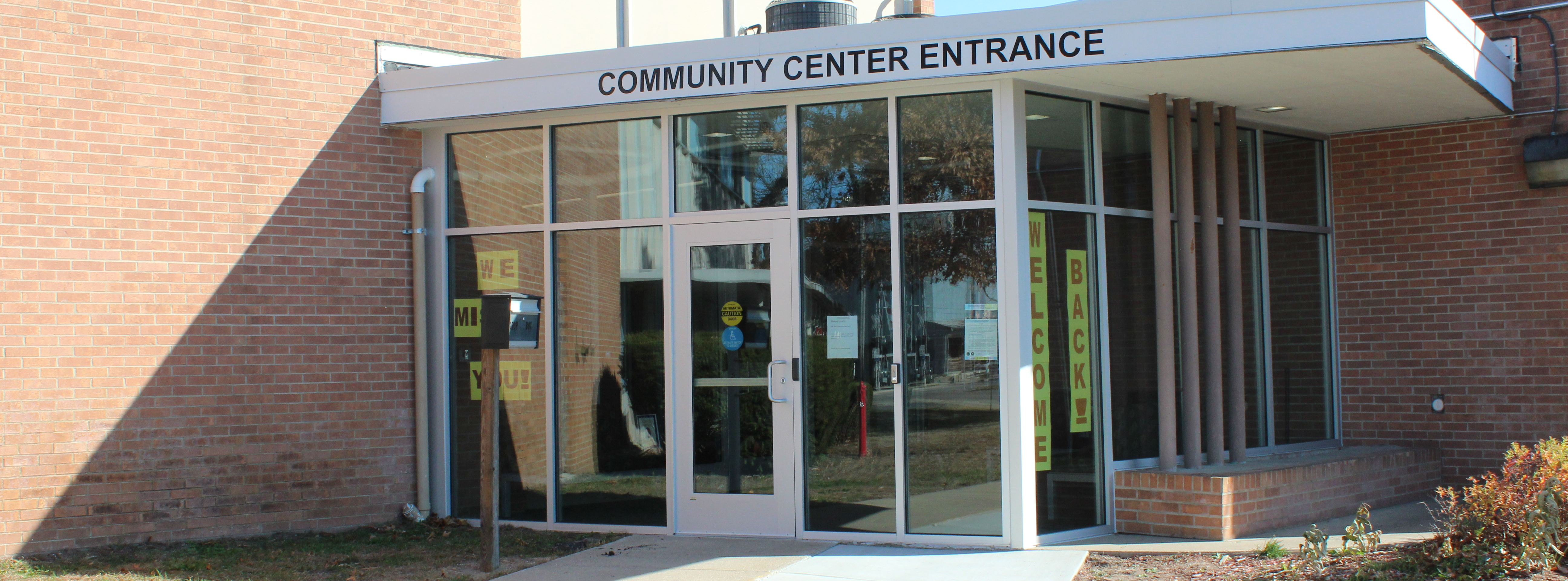 Front entrance to Community Center (front doors and glass windows)