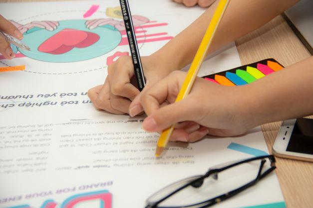 Hands holding pencils