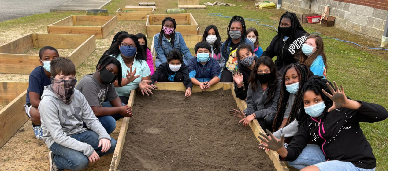Picture of 5th Graders in Garden