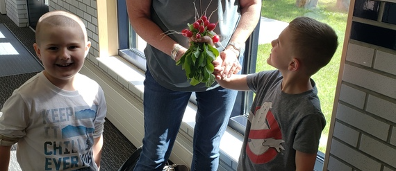 Two students present teacher with plant