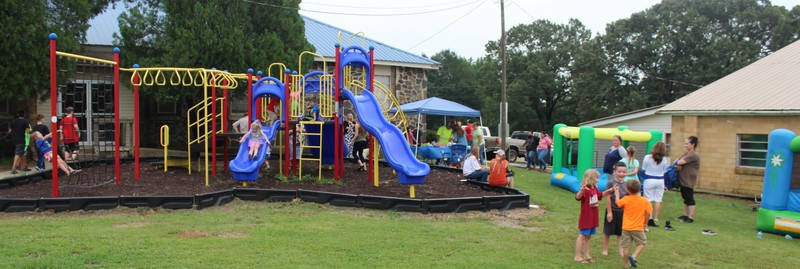 photo of kids playing on a playground
