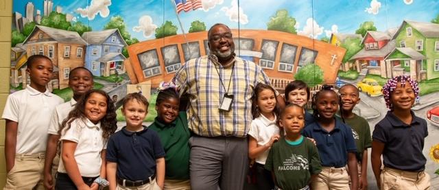 Principal Milner with students