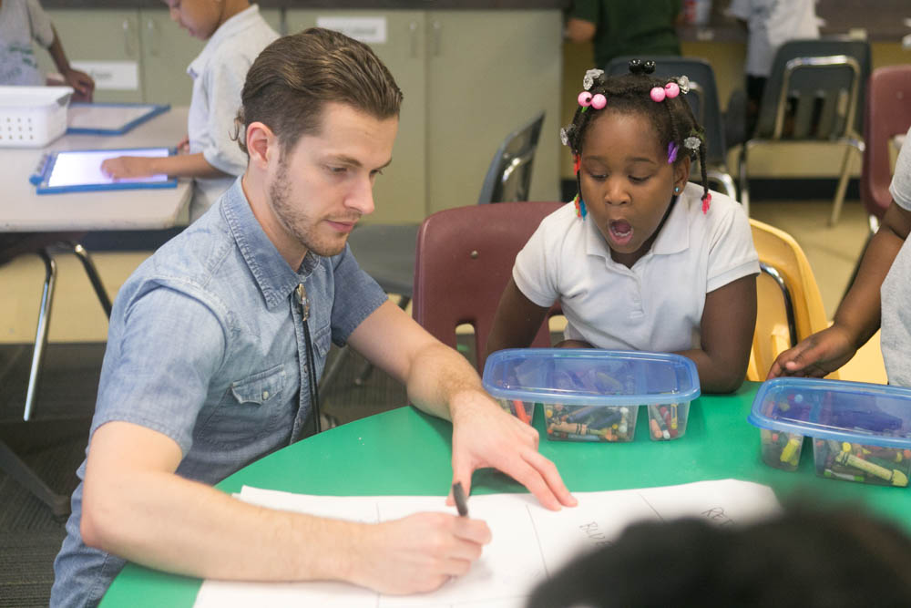 Teacher drawing with student