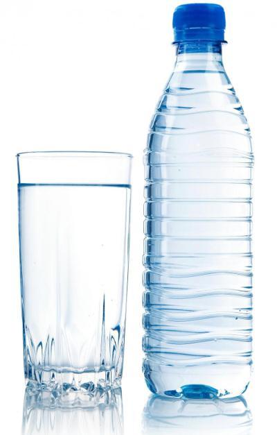 A photo of a glass of water and a bottle of water.