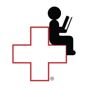 Red cross with a person sitting and reading in the cross.